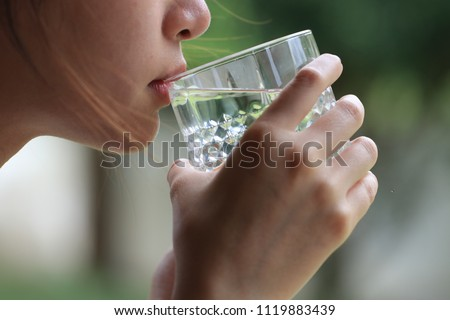 Close​ up​ water drink in​ hand #1119883439