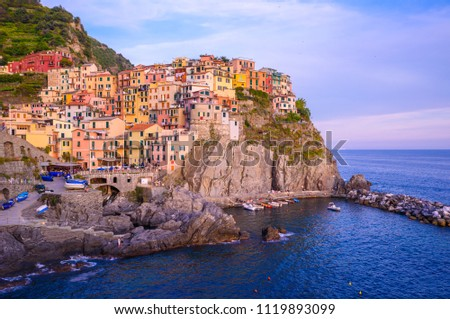 Manarola - Village of Cinque Terre National Park at Coast of Italy. Beautiful colors at sunset. Province of La Spezia, Liguria, in the north of Italy - Travel destination and attractions in Europe #1119893099