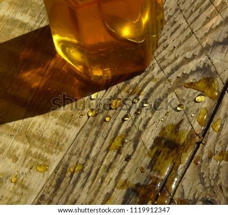 honey in a glass jar on a wooden Board #1119912347