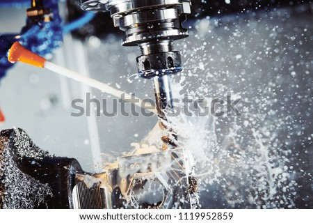 Milling metalworking process. Industrial CNC metal machining by vertical mill. Coolant and lubrication #1119952859
