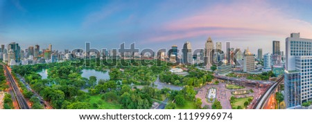 Downtown Bangkok city skyline with Lumpini park  from top view in Thailand at sunset #1119996974