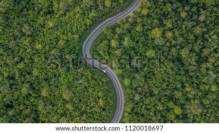 Aerial view of green forest asphalt road, Provincial road adventure passing through tropical rainforest with car, Ecosystem and ecology healthy environment concept, Thailand, Asian, Southeast Asia. #1120018697