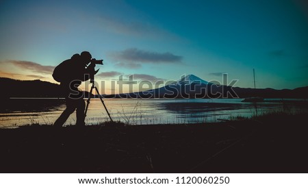 Silhouette Photographer With Fuji Mount Royalty-Free Stock Photo #1120060250