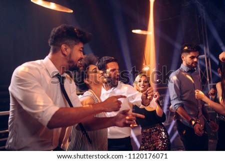 Group of friends dancing in the nightclub #1120176071