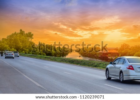 Car driving on road and sunset background travel concept #1120239071