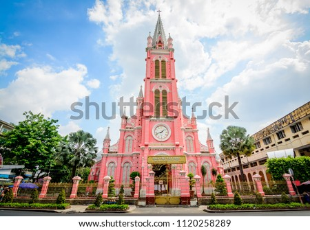 Tan Dinh Church Saigon is a pink, Romanian-style, second largest church in Ho Chi Minh City, Vietnam, where you can see intricate Gothic and Renaissance elements surviving Vietnam's turbulent periods. #1120258289