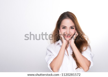 Beautiful asian woman (ages 20-30 years)  happy face, smiling face, both hands catching cheek on white background. #1120281572