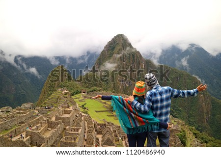 Couple admiring the spectacular view of Machu Picchu, Cusco Region, Urubamba Province, Peru, Archaeological site, UNESCO World Heritage #1120486940