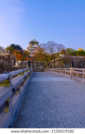 vertical image of beautiful colorful pastel sunrise of Osaka Castle with autumn leaves, landmark of Osaka, Kansai, Japan, landscape, landmark and travel concept #1120619582