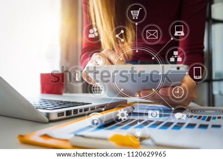 businesswoman or Designer using smart phone with laptop and digital tablet computer and document on desk in modern office with virtual interface graphic icons network diagram  #1120629965