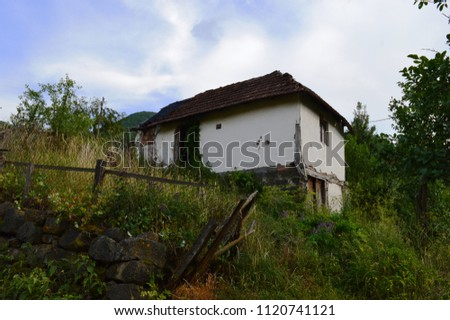 An old white, abandoned house #1120741121