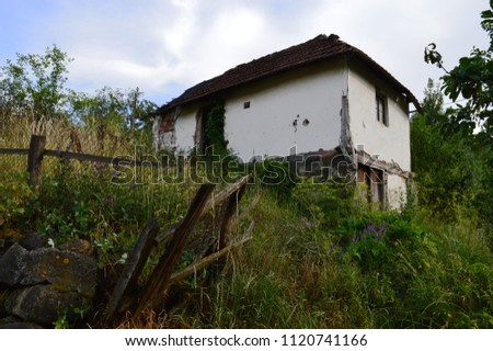 An old white, abandoned house #1120741166