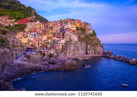 Manarola - Village of Cinque Terre National Park at Coast of Italy. Beautiful colors at sunset. Province of La Spezia, Liguria, in the north of Italy - Travel destination and attractions in Europe. #1120745660