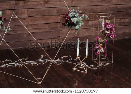 Wedding ceremony. Golden installation with candles and flowers #1120750199