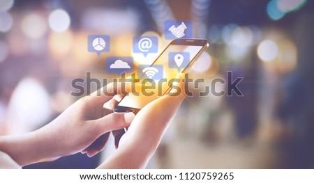 Men who use smart social media concept phones #1120759265