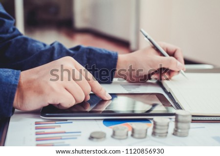 Businessman Working on Project About Business Growth #1120856930