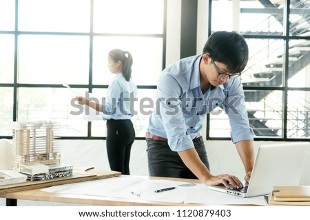 architect or engineer working on table show work hand for business project  #1120879403