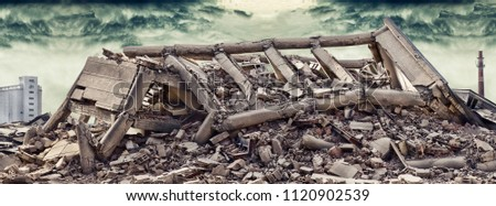 Collapsed concrete industrial building with dramatic sky and factory chimney and another concrete building in background. Disaster scene full of debris, dust and damaged house. #1120902539