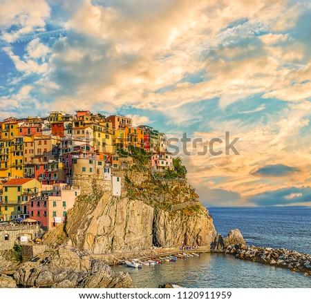 sunset on colorful fishing houses in Italian sea town #1120911959