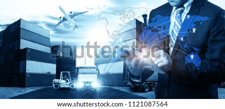 Businessman is pressing button on touch screen interface in front Logistics Industrial Container Cargo freight ship for Concept of fast or instant shipping, Online goods orders worldwide #1121087564