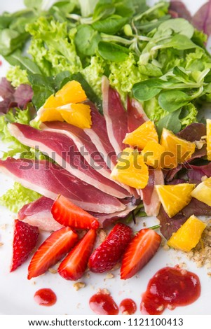 summer salad with berries and meat delicacy #1121100413