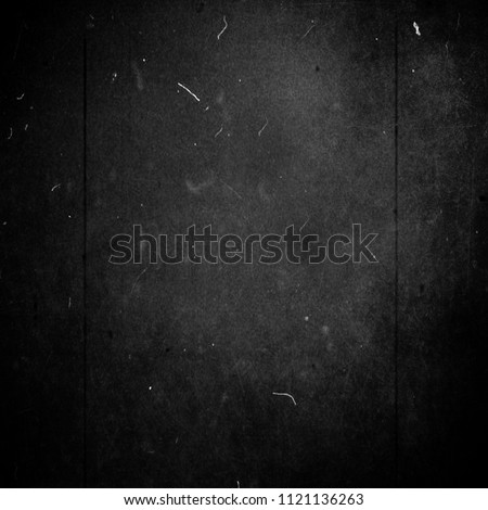 Black scratched grunge background, scary horror texture, old film effect Royalty-Free Stock Photo #1121136263