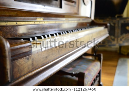 Old, yellowed keys of antique piano #1121267450