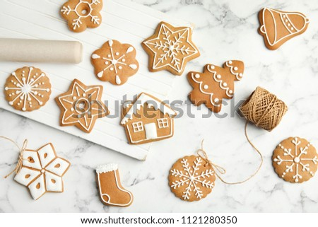 Tasty homemade Christmas cookies on marble table, top view