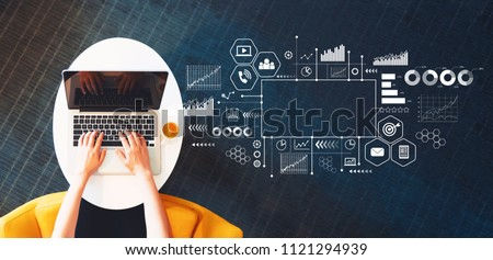 Marketing concept with person using a laptop on a white table Royalty-Free Stock Photo #1121294939
