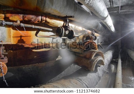 Steam from broken old pipes in underground utility tunnel of water supply pipeline and heat pipeline #1121374682
