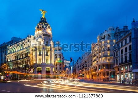 Car and traffic lights on Gran via street, main shopping street in Madrid at night. Spain, Europe. Lanmark in Madrid, Spain #1121377880