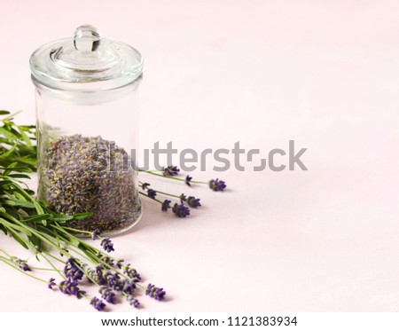 Glass jar with dried lavender and fresh lavender flowers on pink background, copy space #1121383934