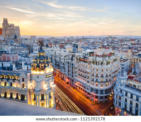 Madrid, Spain - August 2017: Gran Via at night, as seen from the Circulo de Bellas Artes rooftop, with light trails of vehicles passing by in the streets #1121392178