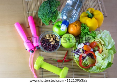 Healthy eating of ketogenic diet meal plan with Workout and fitness dieting ,fitness and weight loss concept, fruit, Vegetable and orange juice,salad,top view on wooden background, Food and health. #1121395355