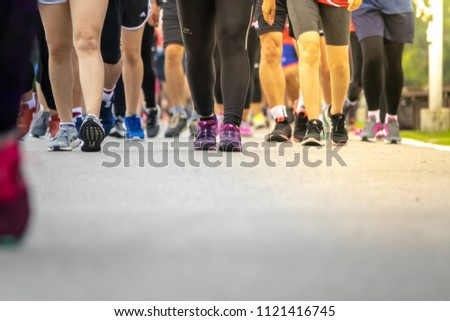 Chiang Mai, Thailand - June 17th, 2018 : Group of Chiang Mai people feet running in marathon running race on June 17th, 2018 in Chiang Mai Thailand #1121416745