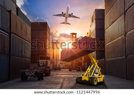 forklift handling container box loading to truck in import export logistic, Business logistics concept #1121447996