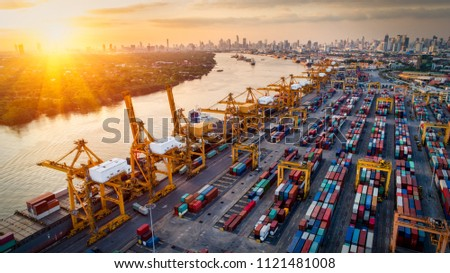 Logistics and transportation of Container Cargo ship and Cargo plane with working crane bridge in shipyard at sunrise, logistic import export and transport industry background #1121481008
