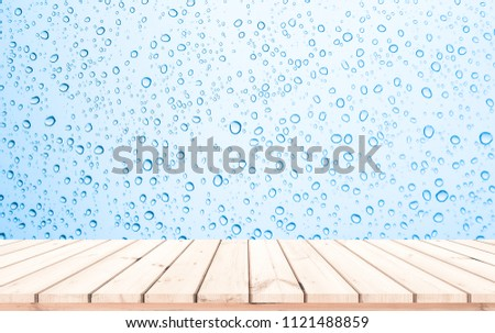 Wood plank with abstract water drop on glass background for product display  #1121488859