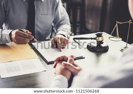 Customer service good cooperation, Consultation between a Businessman and Male lawyer or judge consult having team meeting with client, Law and Legal services concept. #1121506268