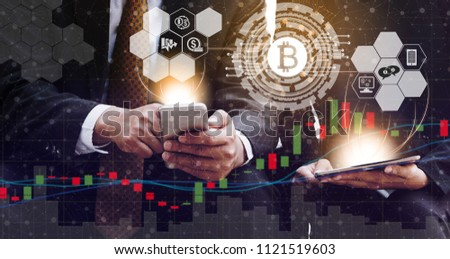 Bitcoin and cryptocurrency investing concept - Businessman using mobile phone application to trade Bitcoin BTC with another trader in modern graphic interface. Blockchain and financial technology. #1121519603