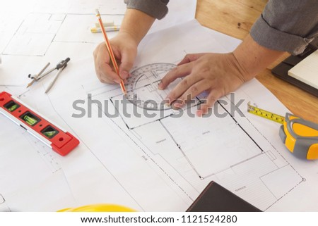 Engineer and Architect concept, Engineer Architects and real estate agent office team working with blueprints #1121524280