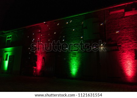 red and green dj ambient lighting design on a barn at a vintage wedding #1121631554