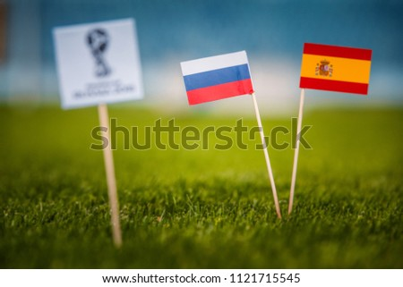 MOSCOW, RUSSIA - APRIL, 24, 2018: Spain - Russia, 16-final, eight final, 1. Junly, Football FIFA World Cup, Russia 2018, National Flags on green grass, white football ball on ground. Play-off #1121715545