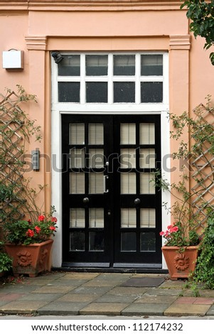 Retro entrance door in front of residential house #112174232