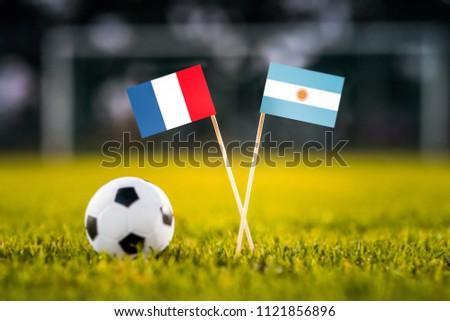 MOSCOW, RUSSIA - APRIL, 24, 2018: France - Argentina, 16-final, eight final, 30. June, Football FIFA World Cup, Russia 2018, National Flags on green grass, white football ball on ground. Play-off #1121856896