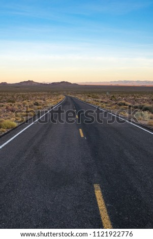 Scenic picture of county road in the desert and the blue sky in Arizona USA