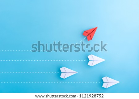 Group of paper plane in one direction and with one individual pointing in the different way. Business concept for new ideas creativity and innovative solution. #1121928752