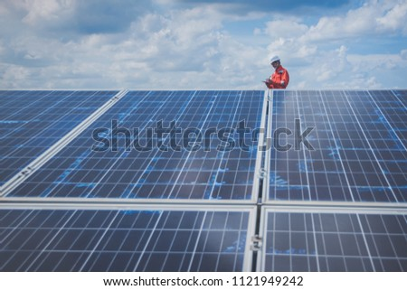 operation and maintenance in solar power plant ; engineering team working on checking and maintenance in solar power plant ,solar power plant to innovation of green energy for life #1121949242