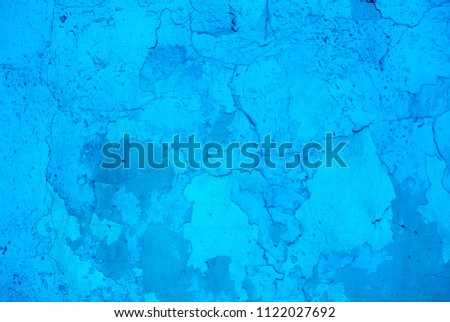 Photo of the intense blue colored rough stucco wall texture #1122027692