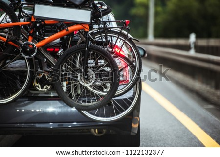 Driving with Hitch Bike Rack. Vacation Time Theme. Royalty-Free Stock Photo #1122132377